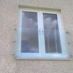 Frameless glass juliet balcony with 6 nr stainless steel glass adaptors