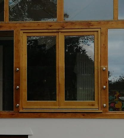 Frameless glass juliette balcony fixed to timber frame